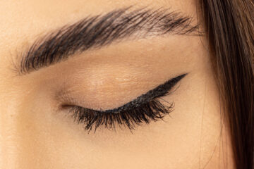 Eyebrow. Eyelashes extensions. Close up